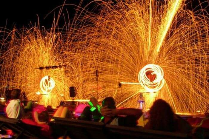Tourists and locals enjoying a fire performance at the Lamai beach