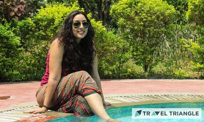 A girl by the swimming pool in Jim Corbett
