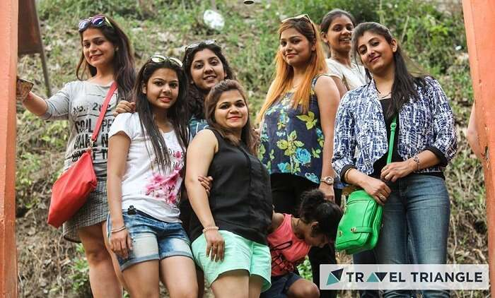 Girls pose for a photo in Jim Corbett