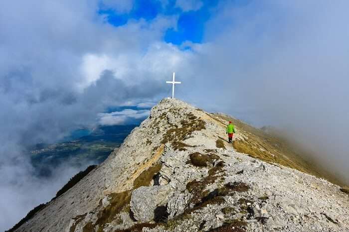 View through the clouds from the top of the Kepa mountain in Karavanke range on the border of Slovenia and Austria