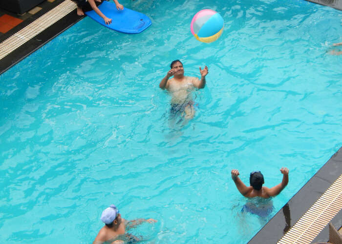 Rajiv Jain and his family enjoying the pool.