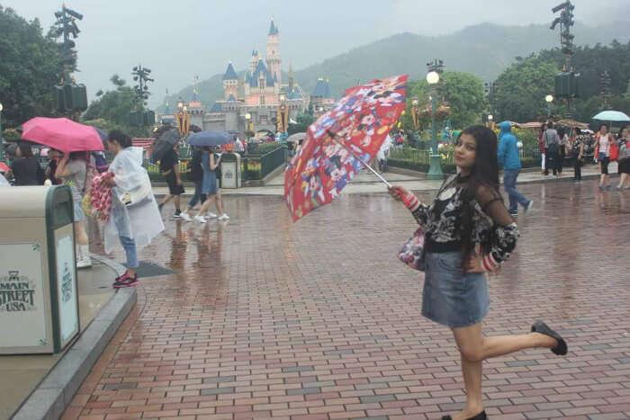 Mitul's wife in Disneyland in Hong Kong
