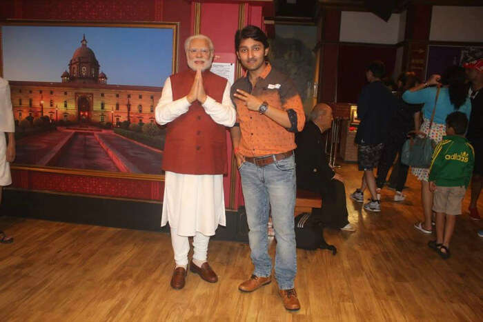 Mitul with a wax statue of Modi in Hong Kong