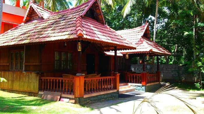 The thatch-roofed hut rooms of God's Own Country Resort - One of the best Ayurveda resorts in Kovalam