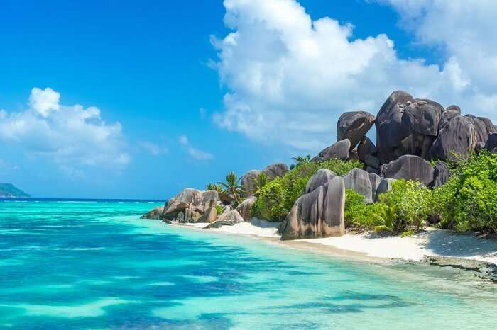 Granite rocks at beautiful beach on tropical island La Digue in Seychelles