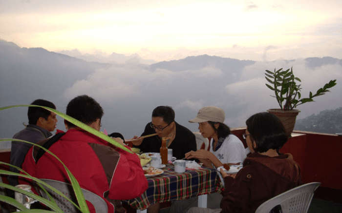 Savor a delicious meal whilst enjoying the beautiful meal from the Hotel Pandim on this holiday in Gangtok