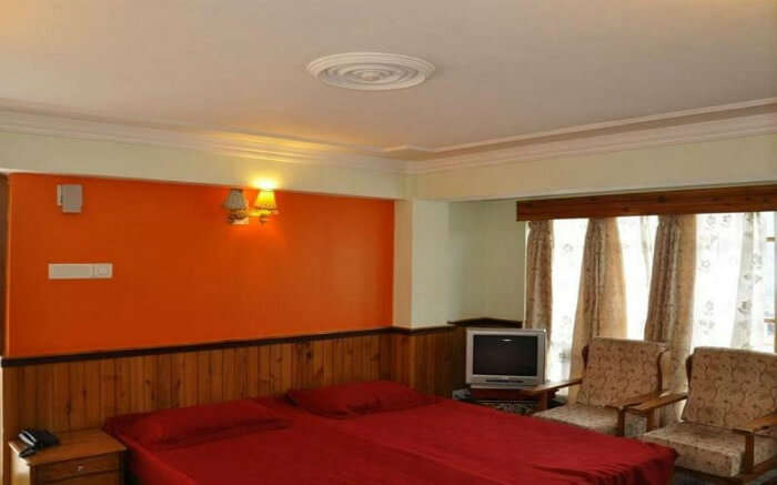Enjoy the grand views of the icy slopes of the mountain ranges in Gangtok at the Hotel Saikripa
