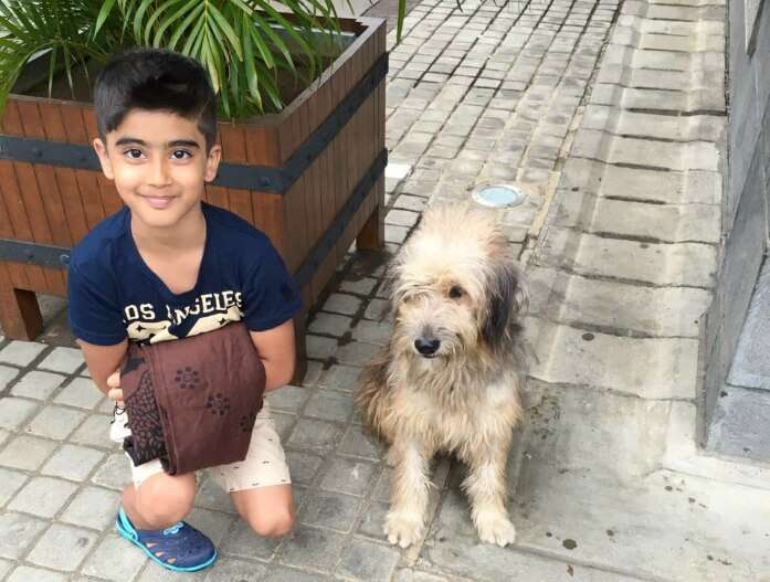 Raj Kumar and his son with a puppy in Port Louis
