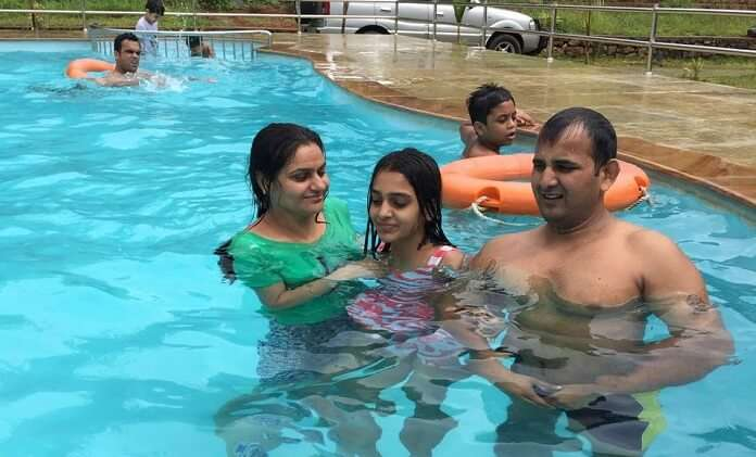 Ravi and his family enjoy at the pool in Kerala
