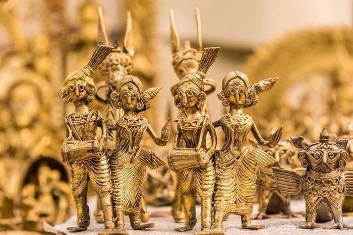Brass and wooden idols at display at Lake Palace Road - one of the best places for street shopping in Udaipur