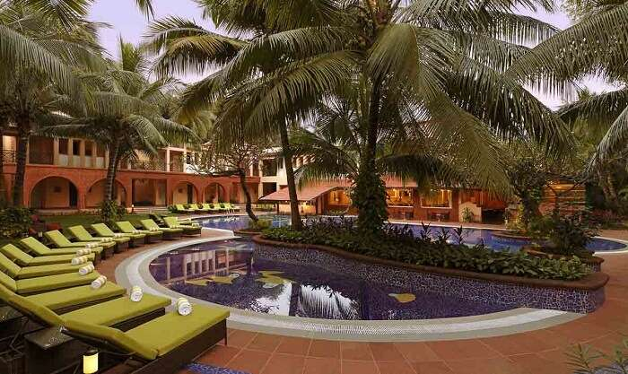 The poolside seating at the Lemon Tree Amarante Beach Resort