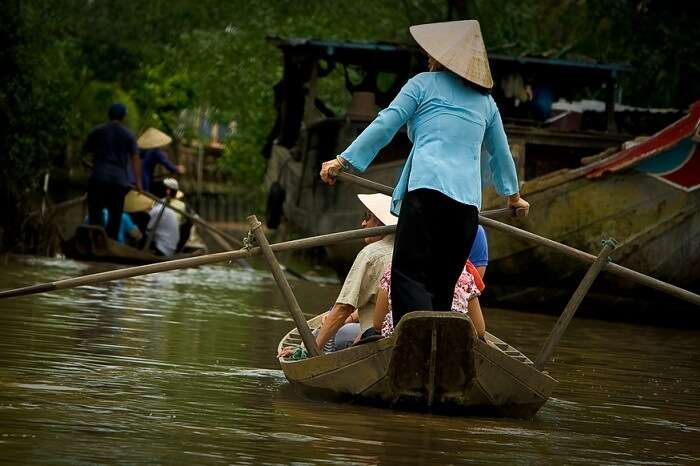 Locals riding a road in the Mekong Delta