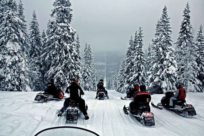 Snowbikers pass through the border of Norway and Sweden