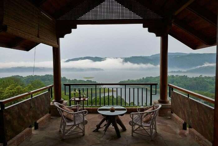 Watch the pristine lake from your cottage at Ri Kynjai in Shillong during monsoons