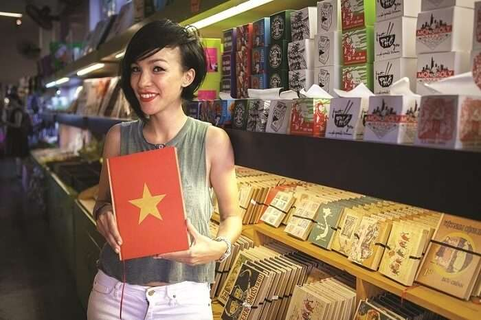 A tourist shops for souvenirs at the Saigon Kitsch in Vietnam