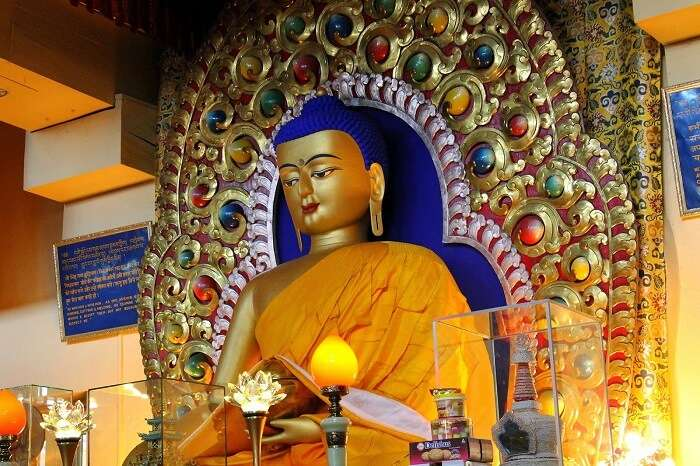 A beautiful sculpture of Lord Buddha at Tsuglagkhang Complex - one of the most sought-after tourist places to visit in Dharamshala