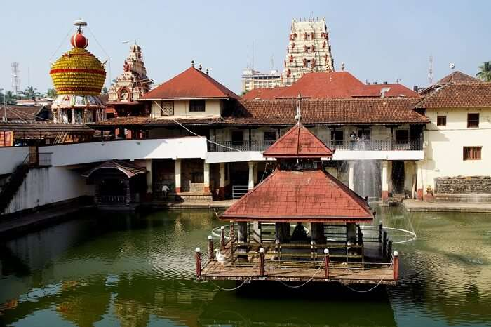 A temple in the middle of water reservoir at Udupi - One of the most religious tourist places to visit in Karnataka