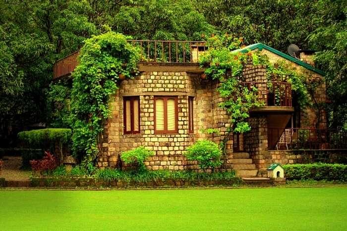 A lovely cottage facing a lush garden at The Den Corbett