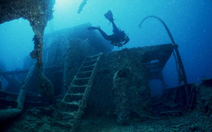A diver explores the Yongala shipwreck in Australia