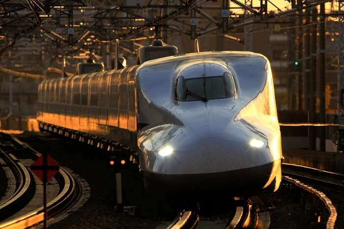 A representative image of the bullet train in India passing through a city