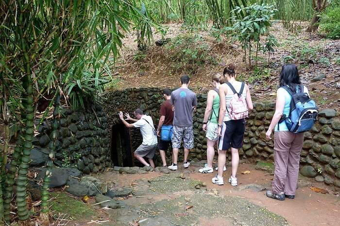 Tourists entering the Cu Chi Tunnel in Vietnam