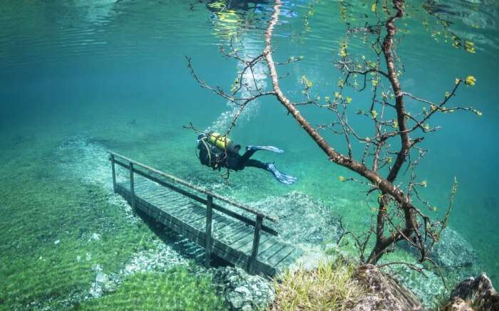 Scuba divers can explore the green grass and benches of this underwater park at Green Lake in Austria.