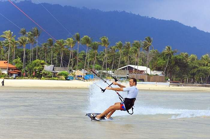 An adventurer tries kitesurfing on Koh Samui island