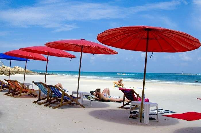 Tourists relax on a beach in Koh Samet