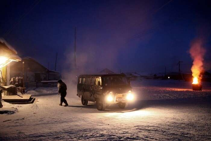 A local leaving the car engines running as he goes to purchase goods from the general store in Oymyakon during winters