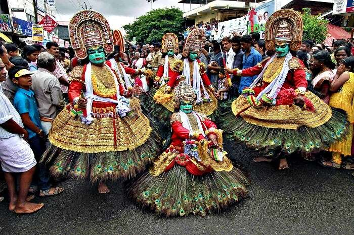 Dancers participate in festivities marking the start of the annual harvest festival of Onam in Kerala