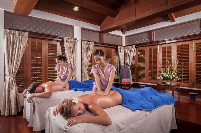 Tourists enjoying Thai massage