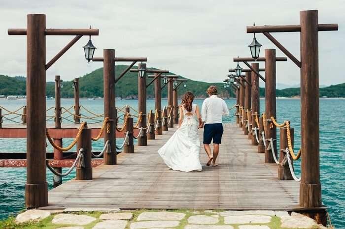 Honeymoon couple relax on beach in Vietnam
