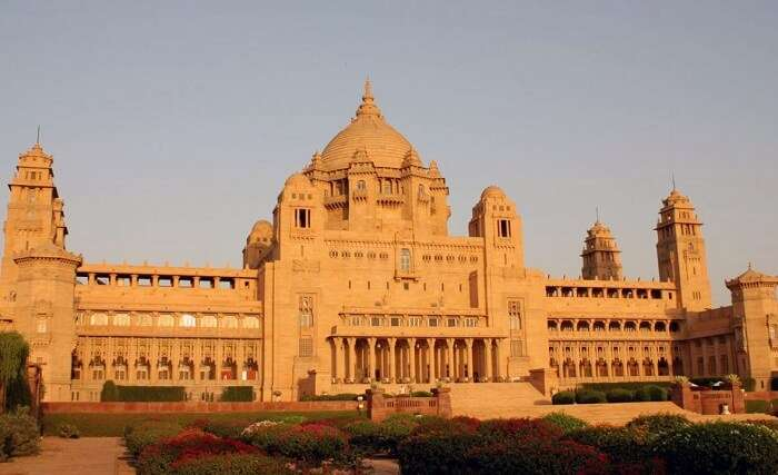 The beautiful garden and the yellow sandstone monument of the Taj Umaid Bhawan Palace