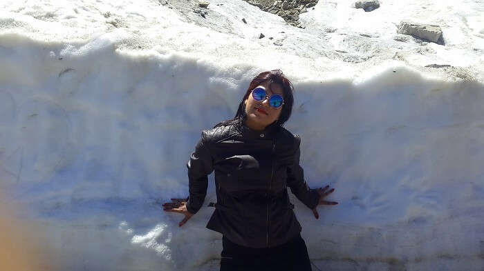 Vishals wife surrounded by snow in Khardungla Pass
