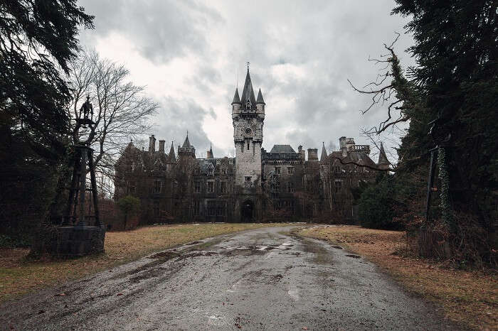 The abandoned and creepy Miranda Castle on a dark and gray day in fall