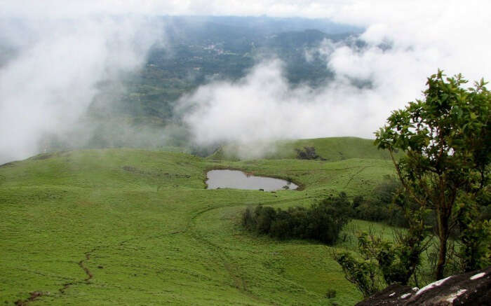 Heart shaped lake in cloud kissed Chembra Peak of Wayanad
