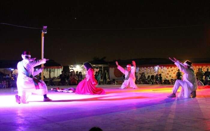 Cultural performance during overnight desert safari tour