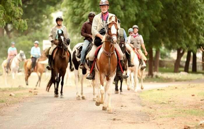 Tourists on a memorable horse safari in Rajasthan