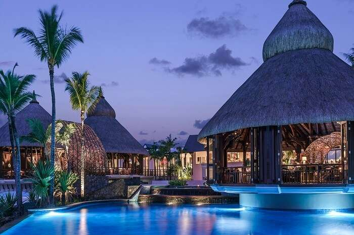 An evening shot of the main pool at the Shangri-La Le Touessrok resort in Mauritius