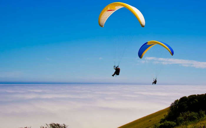 Tourists enjoying paragliding