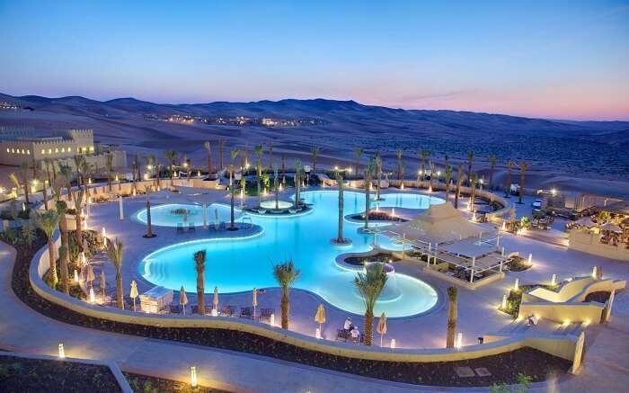 Pool in the desert at the The Qasr Al Sarab Desert Resort Abu Dhabi