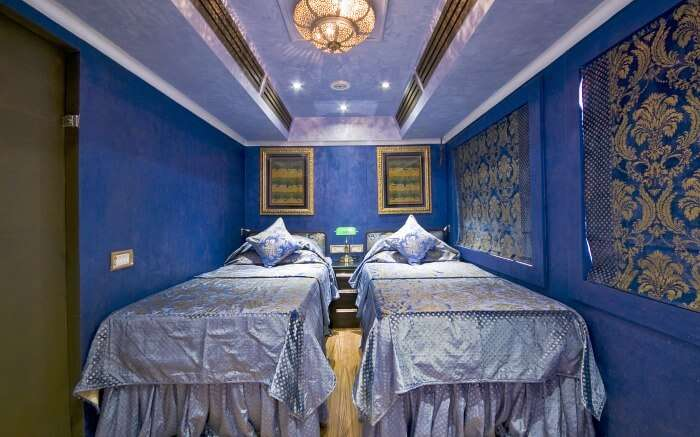 Royal interiors of one of the cabins of Royal Rajasthan on Wheels