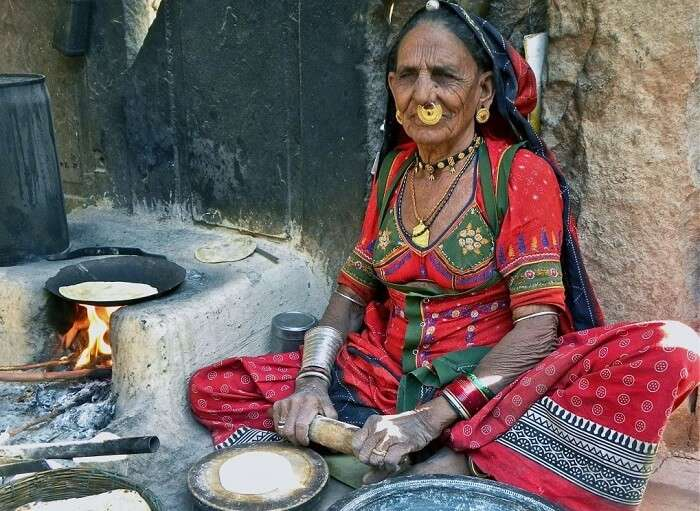 A local lady preparing meal for her family in rural area of Rajasthan