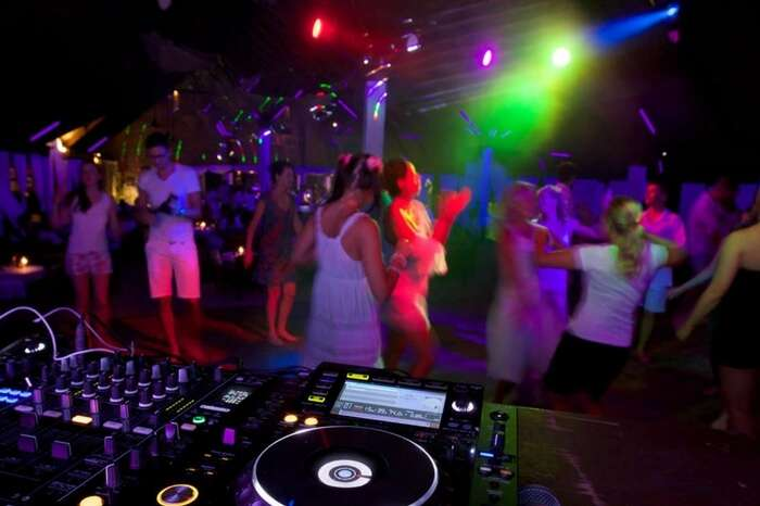 People dancing at a white night party