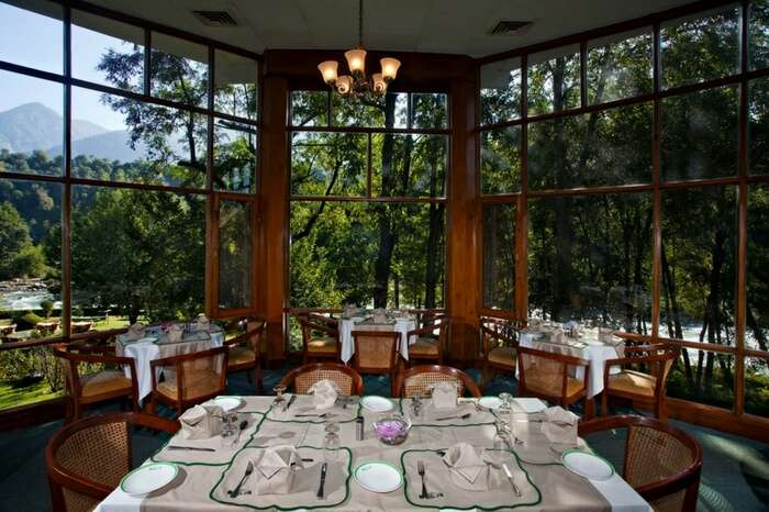 Restaurant at Span Resort & Spa with the backdrop of mountains and river