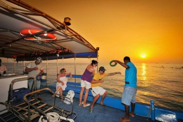 People enjoying night fishing at Bandos Beach in Maldives