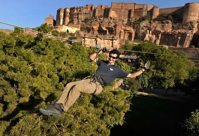 Tourist enjoying zip lining in Rajasthan