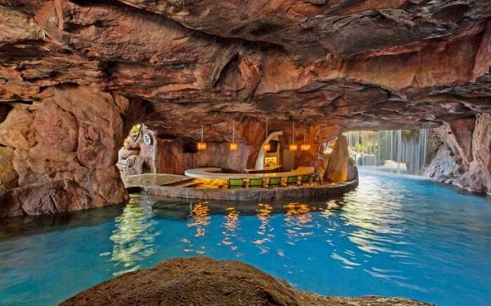 The hotel pool bar in the form of a man-made underground cave at the Hyatt Regency Maui Resort and Spa in Hawaii