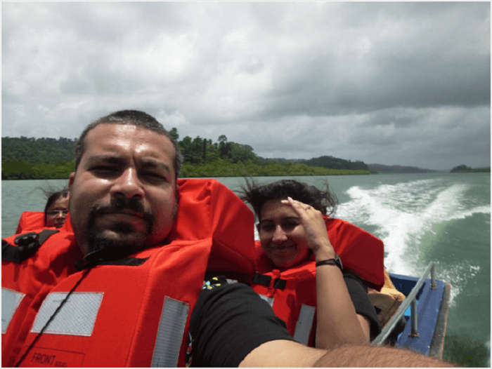 Aashish and his wife in a boat in Andaman