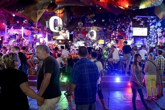 Tourists and locals enjoy the nightlife in Phuket at one of the nightclubs